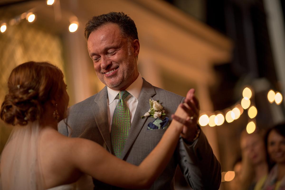 A man and woman dancing at a wedding
